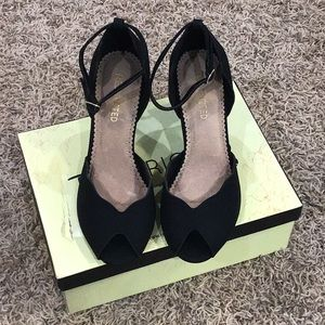 Black heels size 9 by Restricted.